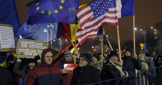 Romania protests endure as president says country in crisis