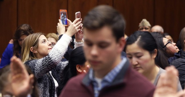 Syrian man leads Pledge of Allegiance at citizenship event