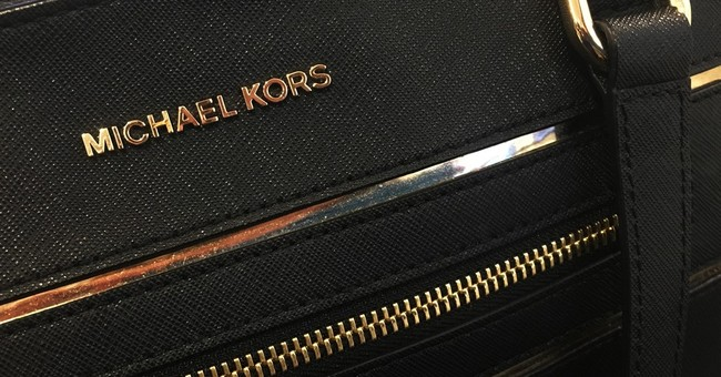 Luxury sector pain spreads, Michael Kors sees weakness ahead