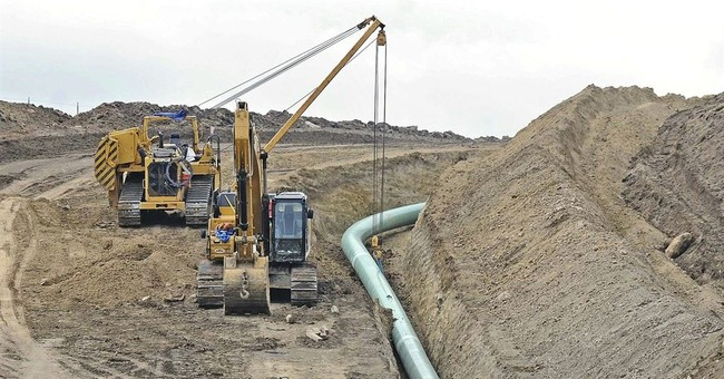 The Latest: Company to resume work on oil pipeline