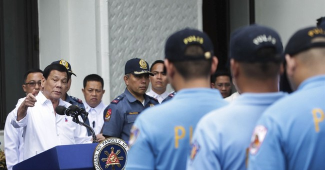 Philippine leader angrily scolds 228 police officers on TV