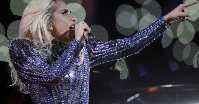 Lady Gaga tells critics 'I'm proud of my body'