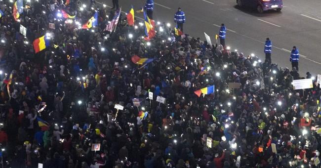 AP Interview: Romanian president praises protesters