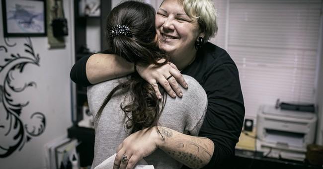 Russian tattoo artist turns abuse scars into butterflies