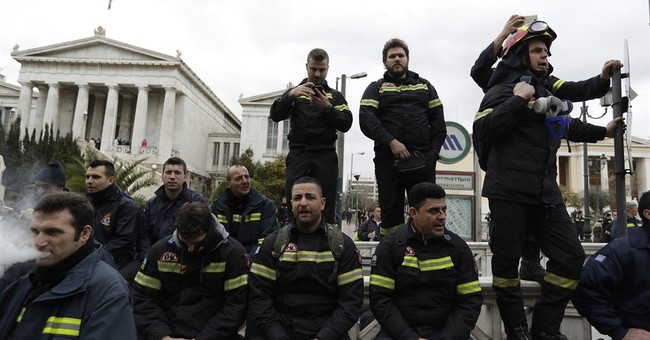 Greek firefighters take to streets over hiring conditions