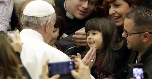 Pope repeats 'bridges not walls' after Trump travel ban