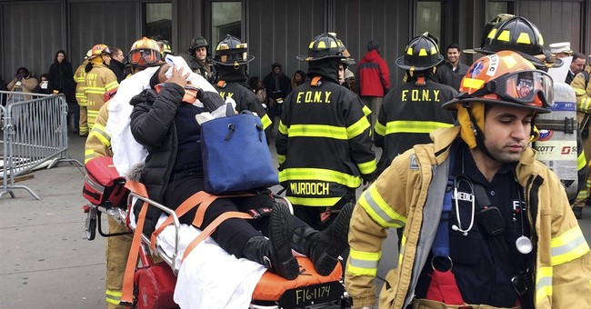 The Latest: Train derailment probe expected to take days