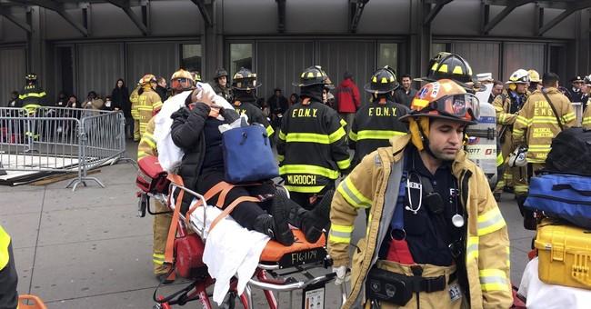 Train crashes at end of platform; 100 people injured