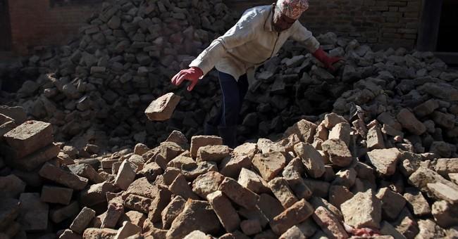 Tired of the cold wait, Nepal quake survivors rebuild