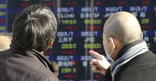 Asian shares mixed as investors consider latest Fed minutes