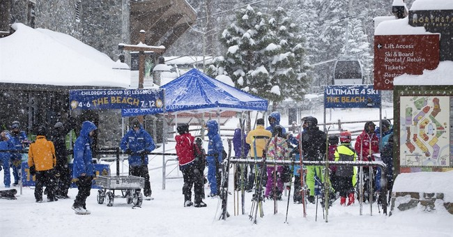 The Latest: Heavy snow closes I-80 in Sierra