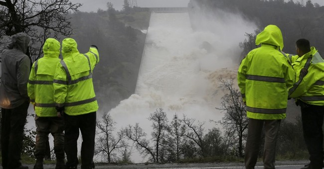 The Latest: Emergency spillway use goes on at California dam