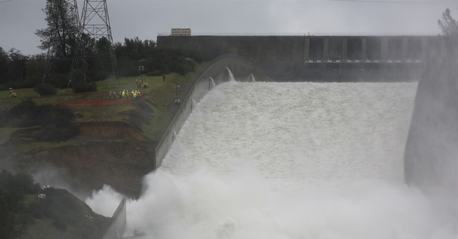 Gaping hole in spillway for tallest US dam keeps growing