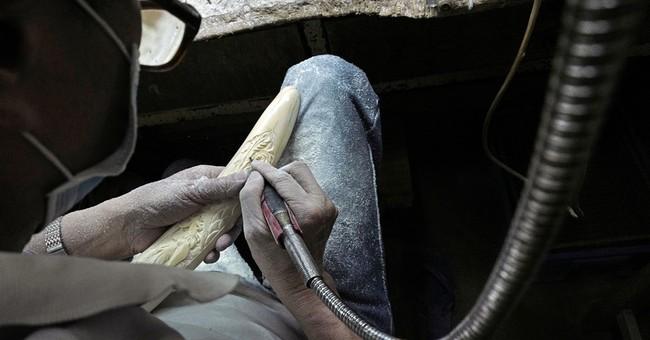 Hong Kong ivory trade faces uncertain future as bans loom