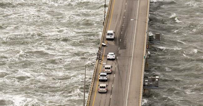 Truck plunges off bridge; driver dies after copter rescue