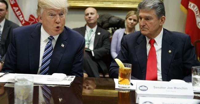 Trump woos senators on Gorsuch, escalates against Democrat