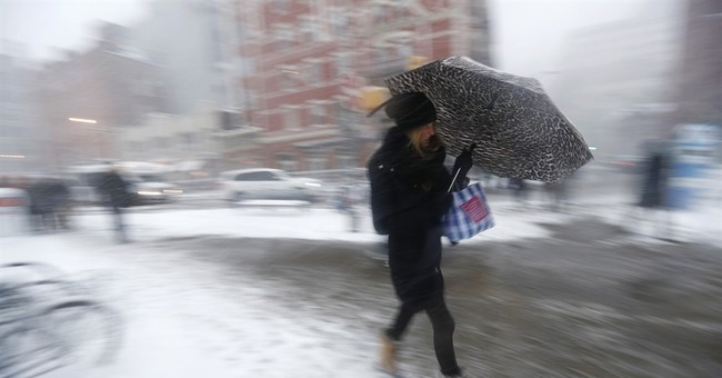The Latest: Drivers getting stuck on NY roads during storm