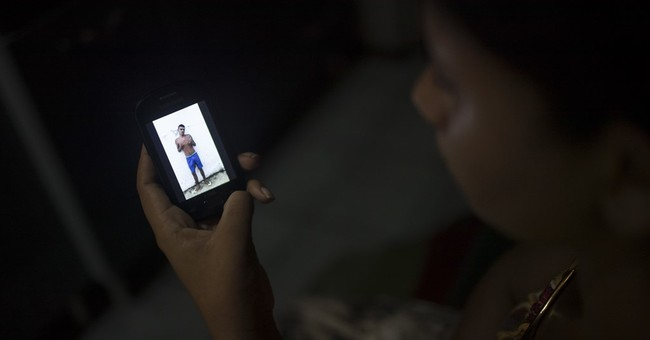 Gruesome videos, not officials, tell of Brazil prison deaths