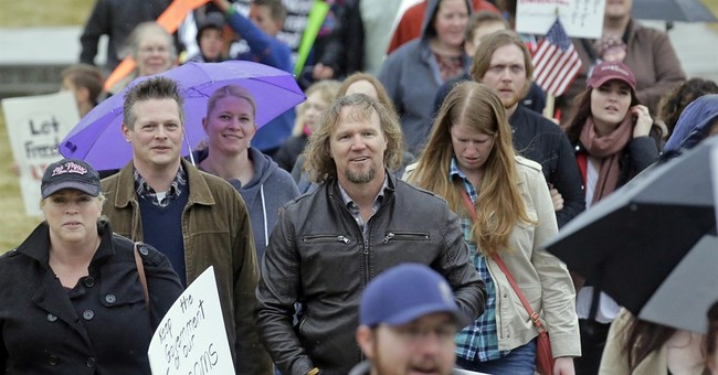 Polygamous families protest bigamy law at Utah Capitol