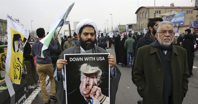 Iranians trample on US flag, mark 1979 Islamic Revolution