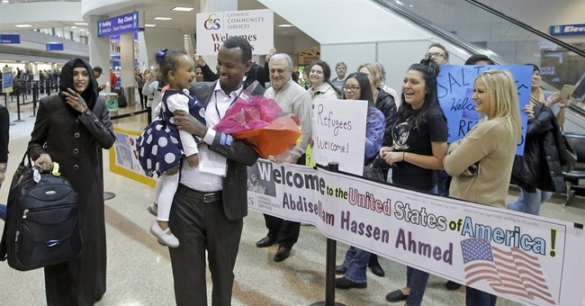 With travel ban blocked, refugee meets daughter for 1st time