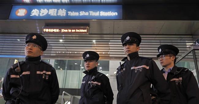 Hong Kong police arrest man after 18 injured in subway fire