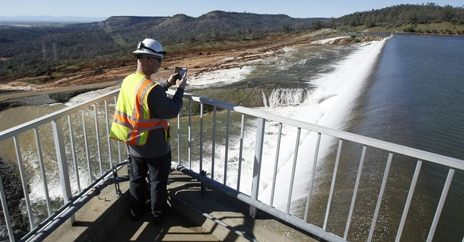 The Latest: State officials await dawn to inspect spillway