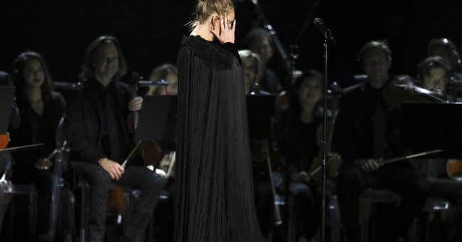 Adele starts over during George Michael tribute at Grammys