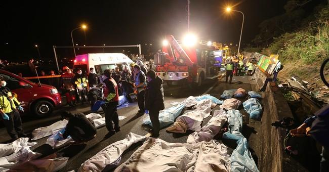 Speed a possible factor in Taiwan bus crash that killed 32