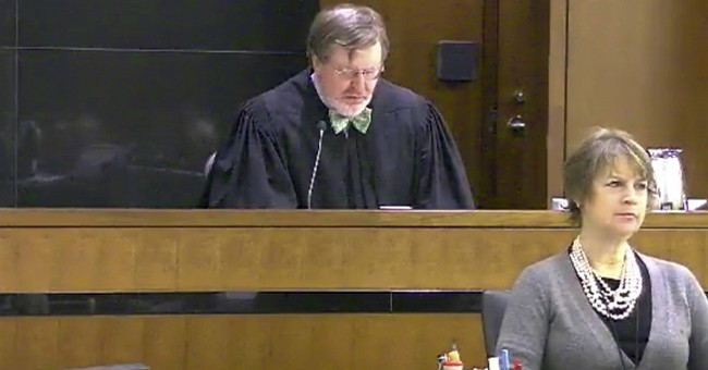 Judge says Trump travel ban case can proceed in lower court
