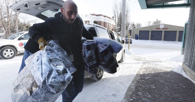 Desperate immigrants risk perilous winter trek to Canada