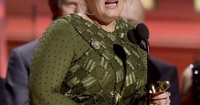 Adele wins top Grammys, but pays tribute to Beyonce