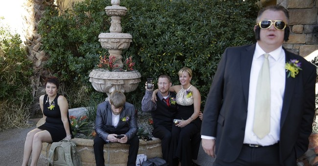 AP PHOTOS: Dozens get hitched on Valentine's Day in Vegas