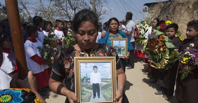 Guatemala buries 2 murdered children found in sacks