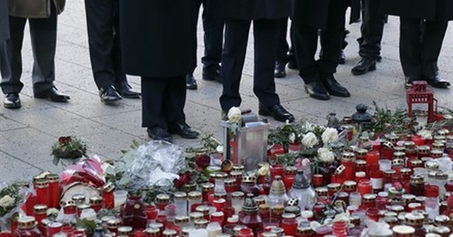Merkel, Tunisian premier pay tribute to Berlin attack dead