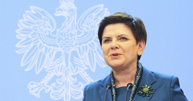Man charged in car crash that injured Polish prime minister