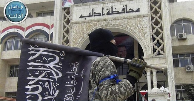Clashes between 2 extremist groups kill scores in Syria