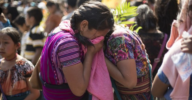 Guatemala buries 2 murdered children found in sacks