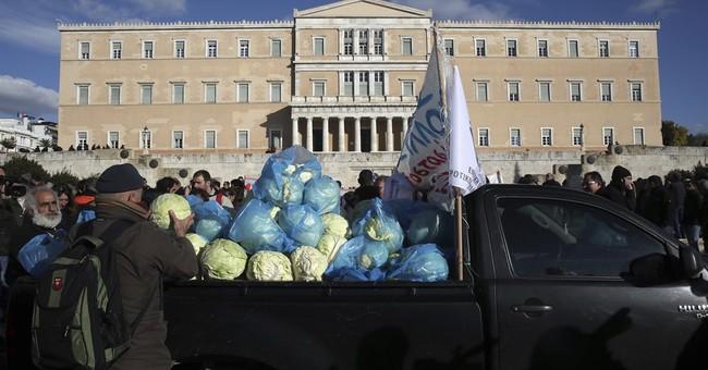 Greek bailout impasse needs more talks, eurozone chief warns