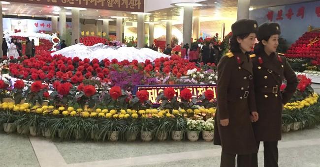 North Korea celebrates late leader, recent missile launch