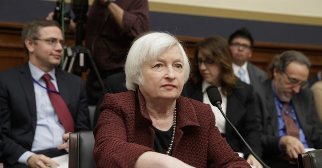 The Latest: Yellen opposes limits to Fed independence