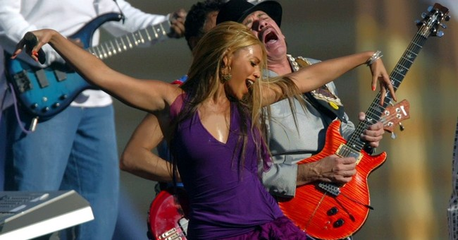 Carlos Santana says praise for Adele wasn't dig at Beyonce