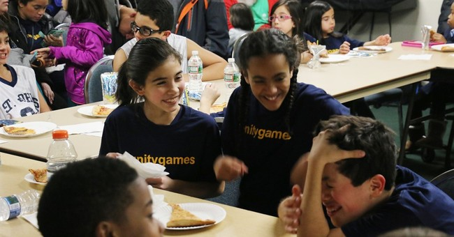 Game on! Archdiocese lets girls back on boys' CYO hoop team