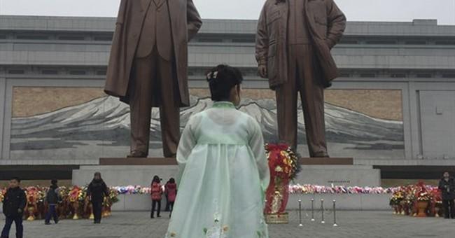 North Koreans, in eye of storm, fete leader's birthday
