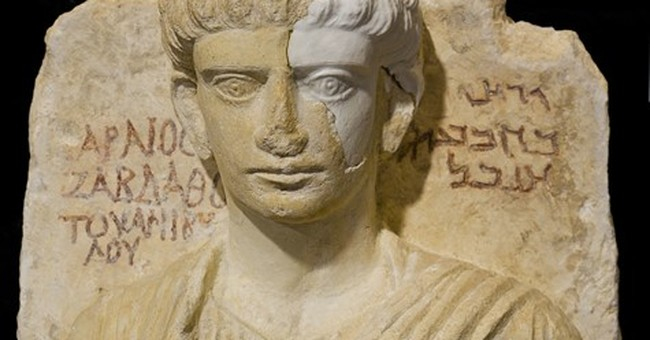 Italian teams restore damaged busts from ancient Syrian city