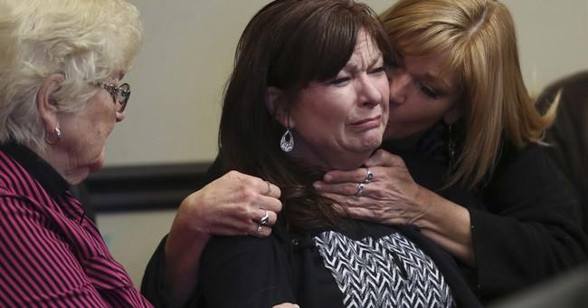 Mother of Utah man shot by police settles lawsuit