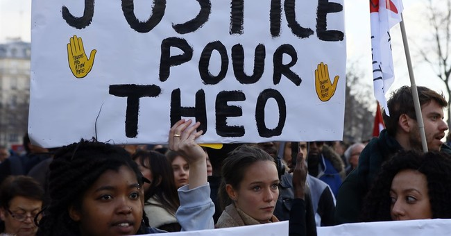 Paris protesters decry police abuse; some clash with police