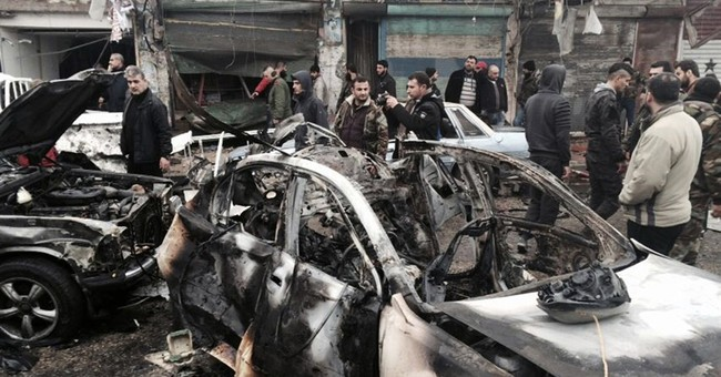 Despite Syria truce, car bomb kills 10 in Assad stronghold