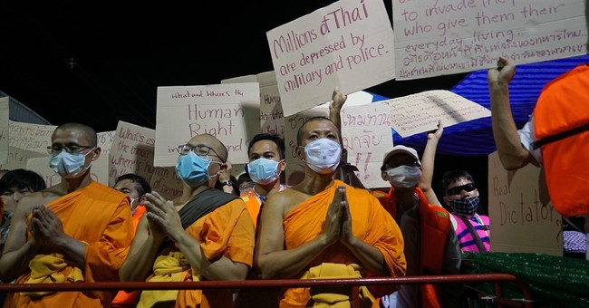 Police hunting for monk increase pressure on Thai temple