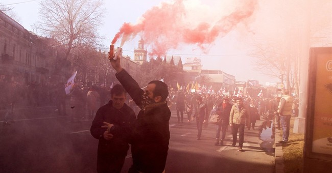 Thousands protest in Georgia to back opposition TV station